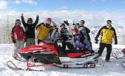 Happy Snowmobile Tour Riders